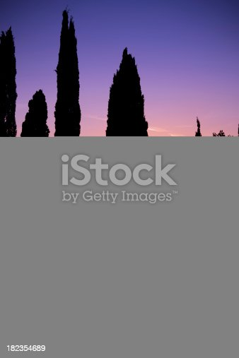 istock Young woman running in dark street and glancing back 182354689