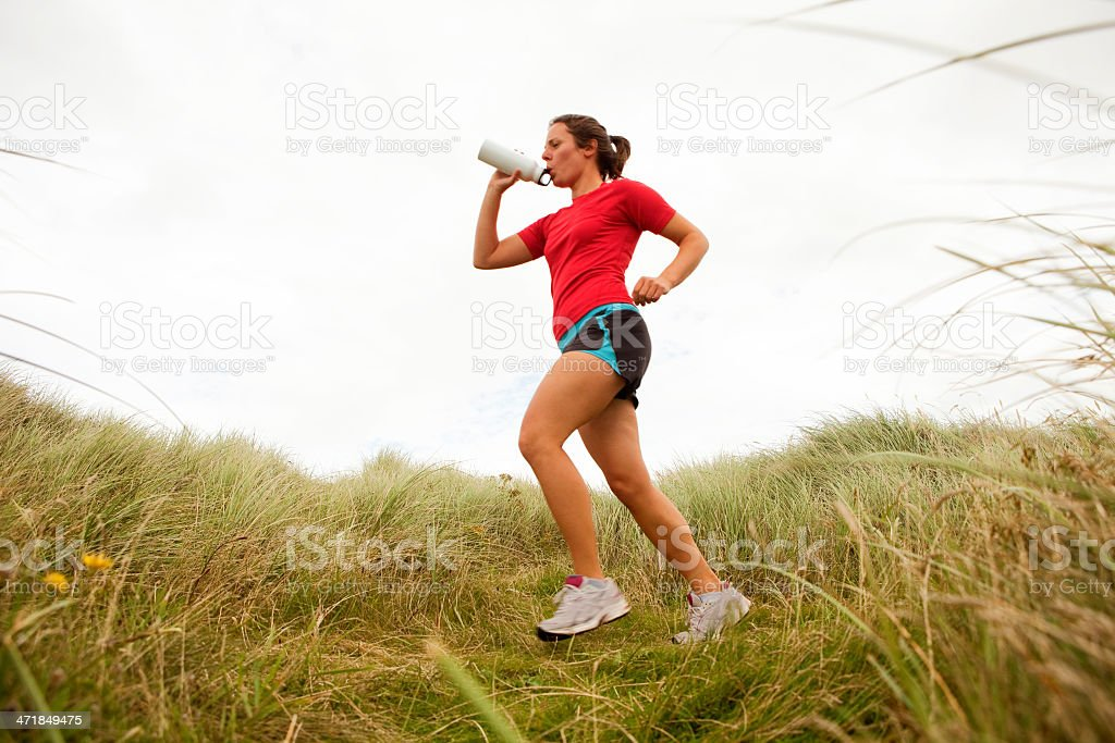 Young woman running in the Great outdoors royalty-free stock photo