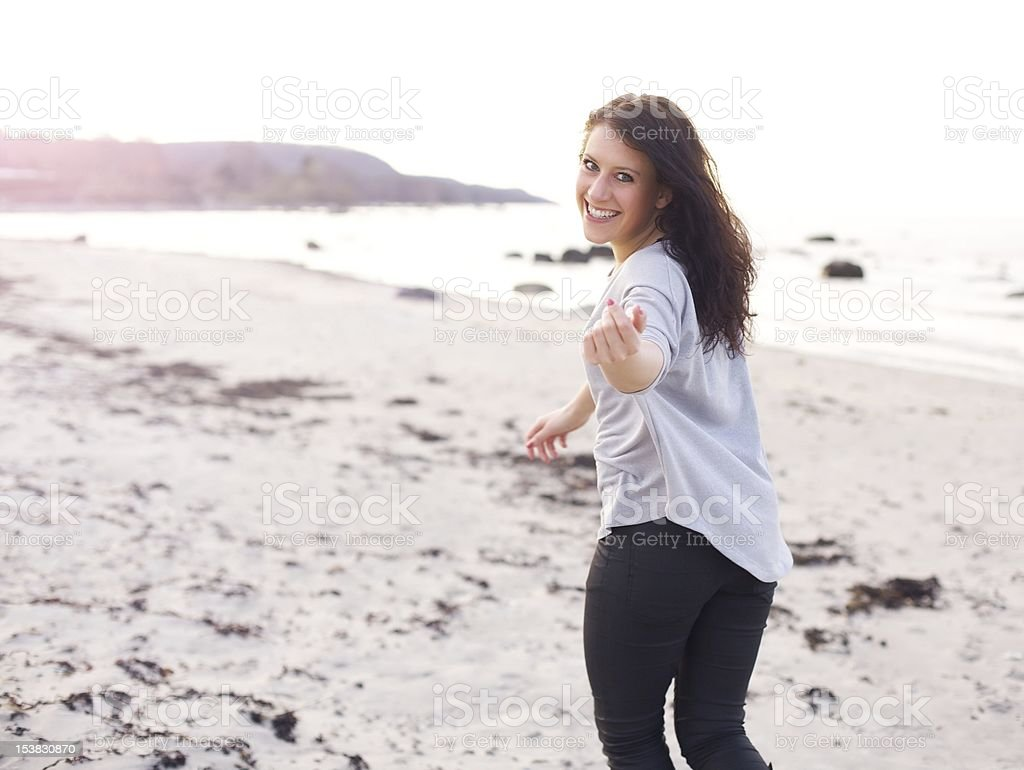 Young Woman Running, Inviting You to Come Closer royalty-free stock photo