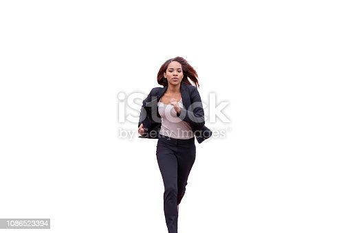 Young brunette woman in black office clothes running rapidly towards camera. Isolated on white