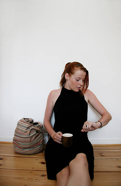 Young woman running late stock photo