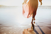 istock Young woman running on seaside path. 1148904693