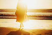 istock Young woman running on seaside path. 1150763034