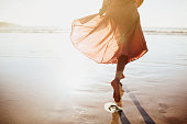 istock Young woman running on seaside path. 1153222771