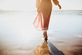 istock Young woman running on seaside path. 1159211178