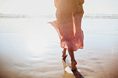 istock Young woman running on seaside path. 1160939387