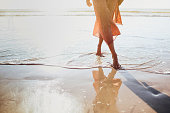 istock Young woman running on seaside path. 1171921389