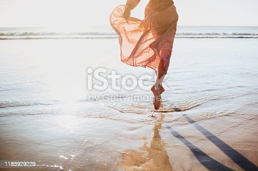 Young woman running on seaside path. summer time.