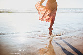 istock Young woman running on seaside path. 1183929229