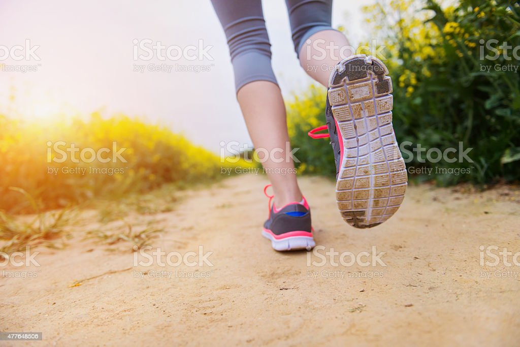 Young woman running stock photo
