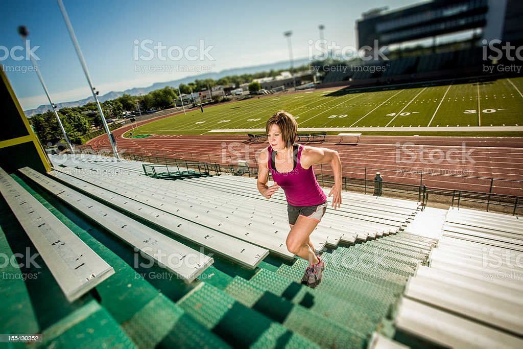 Young Woman Running Stairlaps royalty-free stock photo
