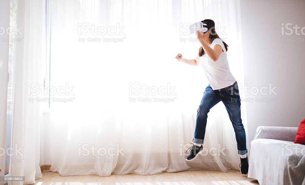 Young woman running virtualy stock photo