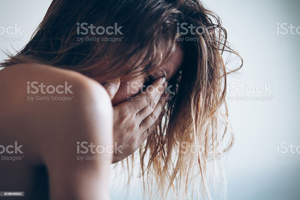 Young woman sad and crying stock photo