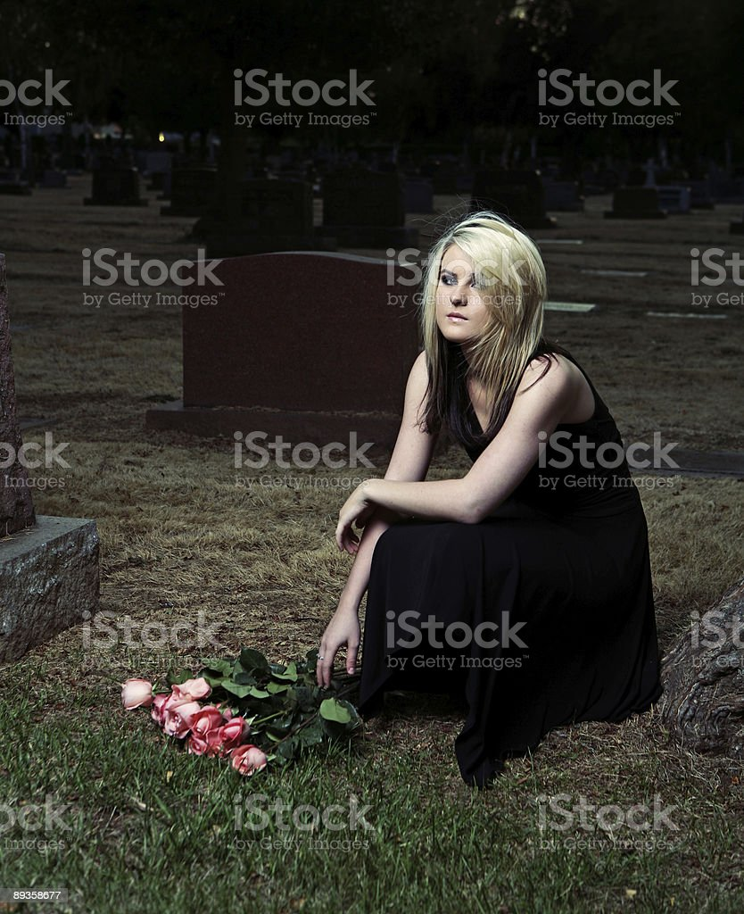 Young Woman Sad at a Cemetery royalty free stockfoto