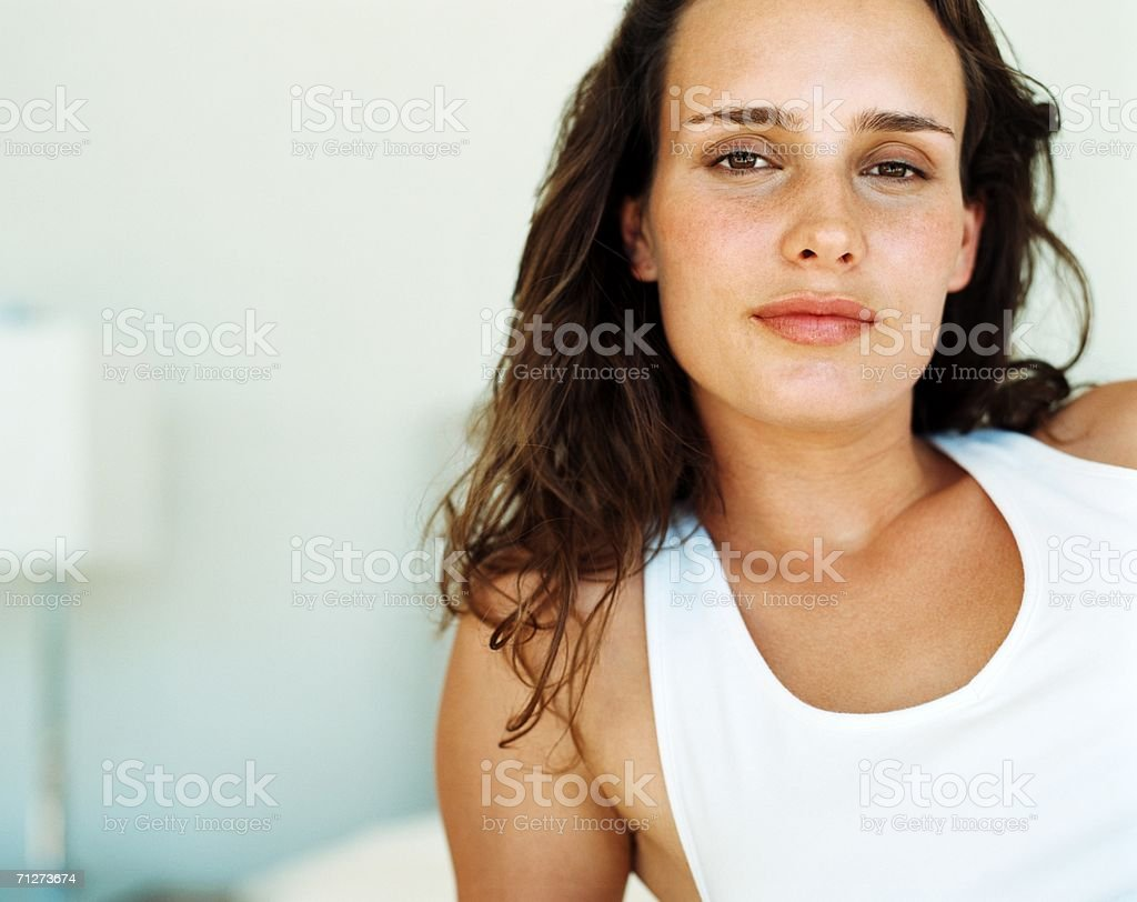 Young woman sat on bed royalty-free stock photo