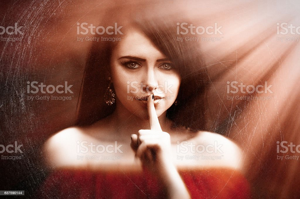 Young woman saying shh with forefinger on lips. silence gesture - foto de stock