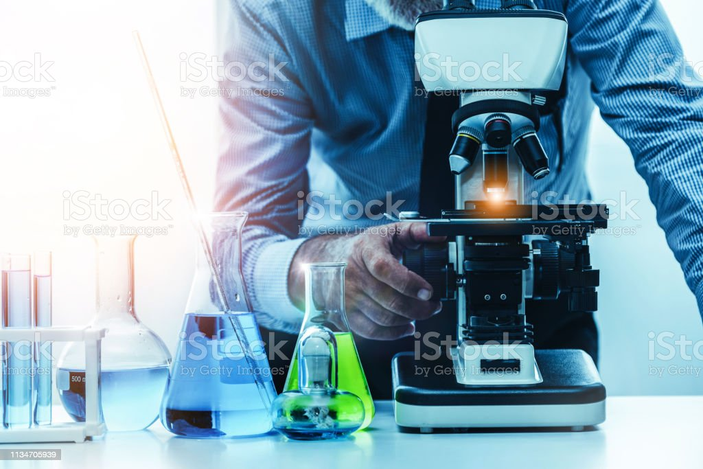 Young Woman Scientist Working In Chemical Laboratory And
