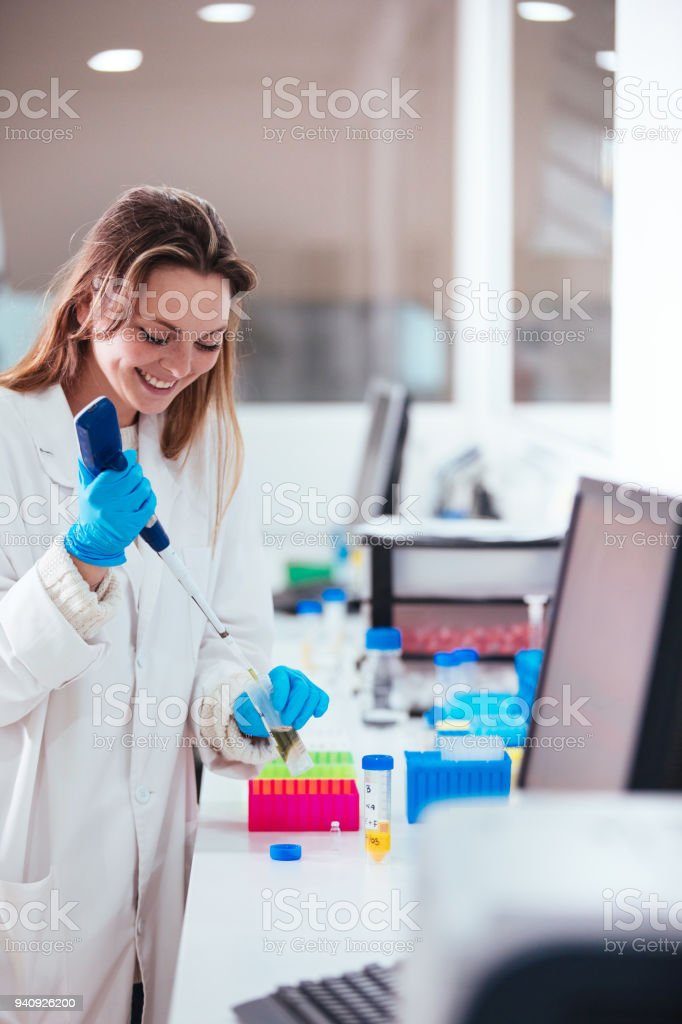 young woman scientist working with a pipette in a laboratory stock photo