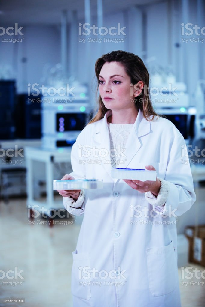 young woman scientist working with equipment in a laboratory stock photo