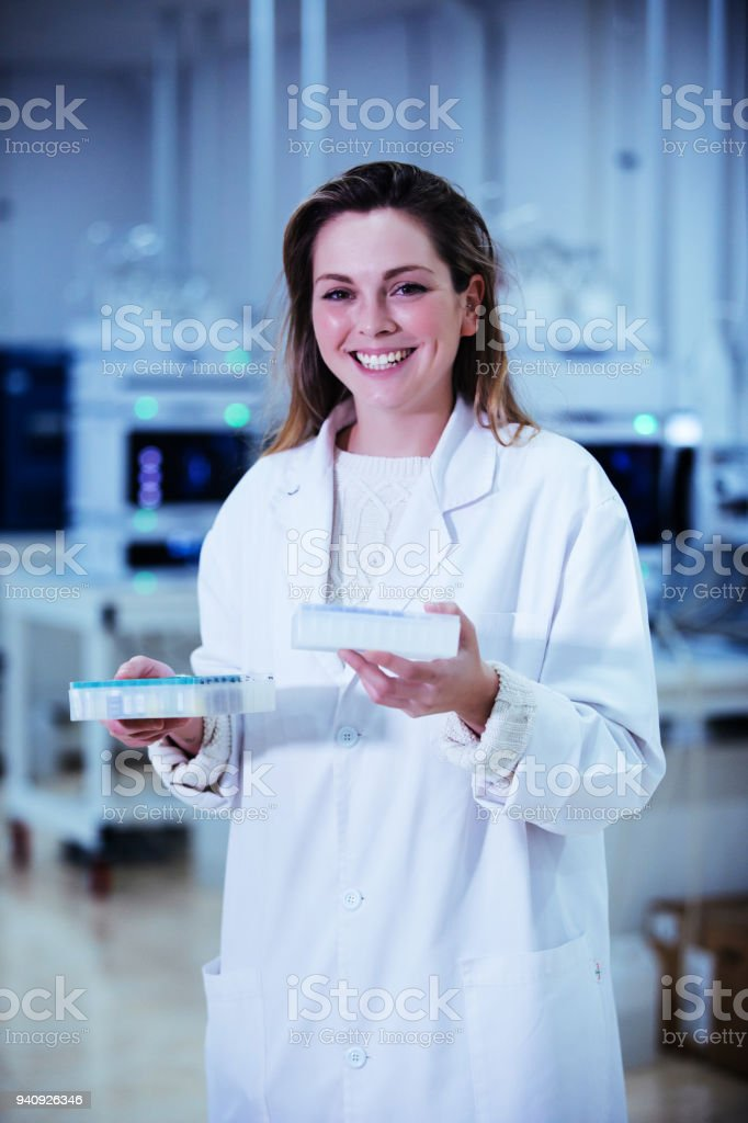 young woman scientist working with samples in microplates in a laboratory stock photo