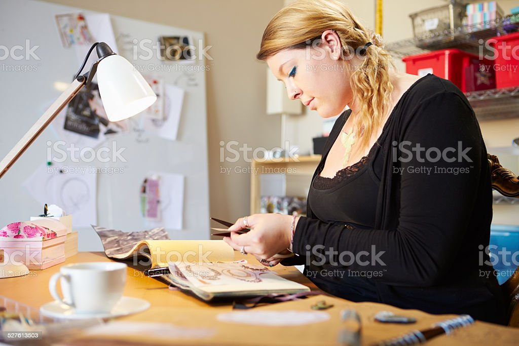 Young Woman Scrapbooking At Home stock photo