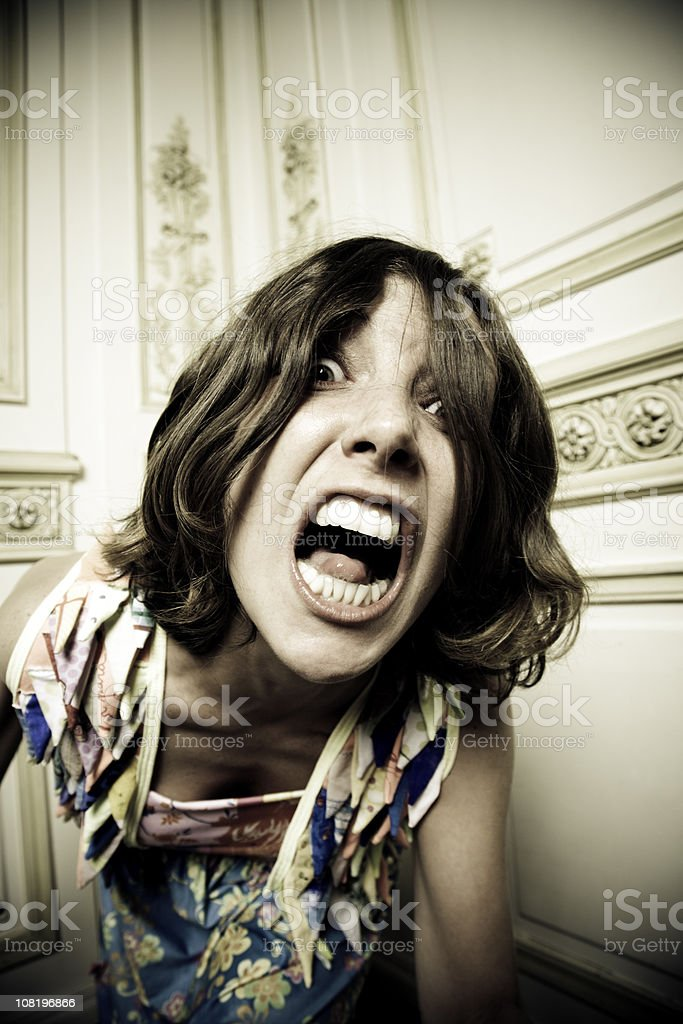 Young Woman Screaming and Looking at Camera royalty-free stock photo