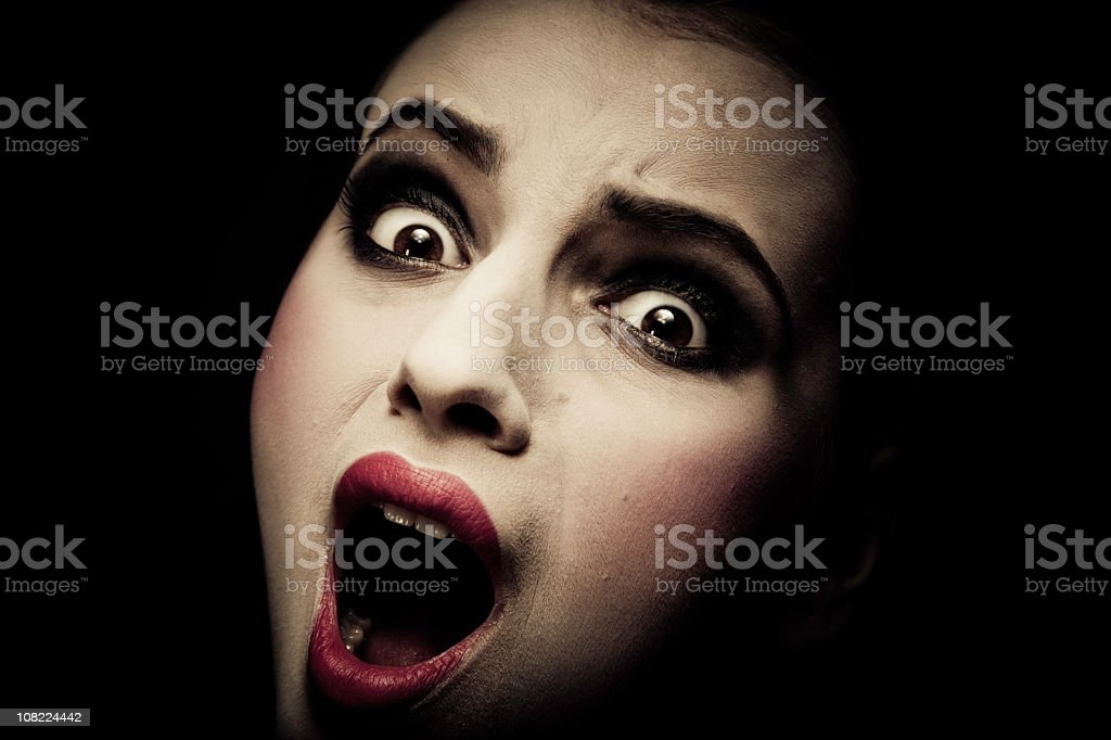 Young Woman Screaming, low key royalty-free stock photo