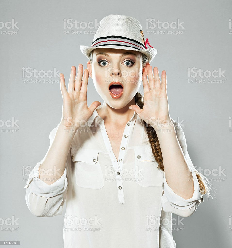 Young woman screaming, Studio Portrait royalty-free stock photo