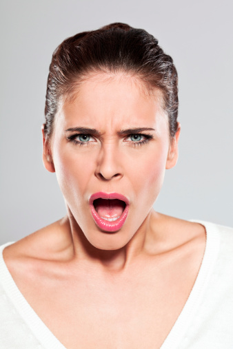 Young Woman Screaming Studio Portrait Stock Photo - Download Image Now