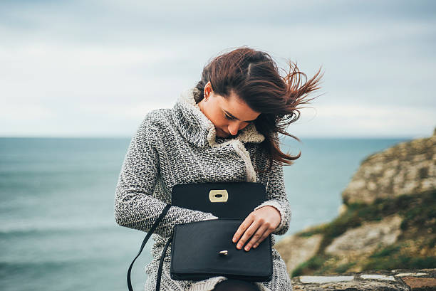 young woman searching in her purse - lost stock photos and pictures