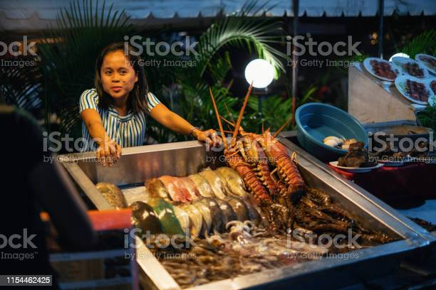 Young woman sell seafood on street market philippines picture id1154462425?b=1&k=6&m=1154462425&s=612x612&h=k4pq0quhpc6amazt7rt i sqlvqckrt17d6y0zr35bs=