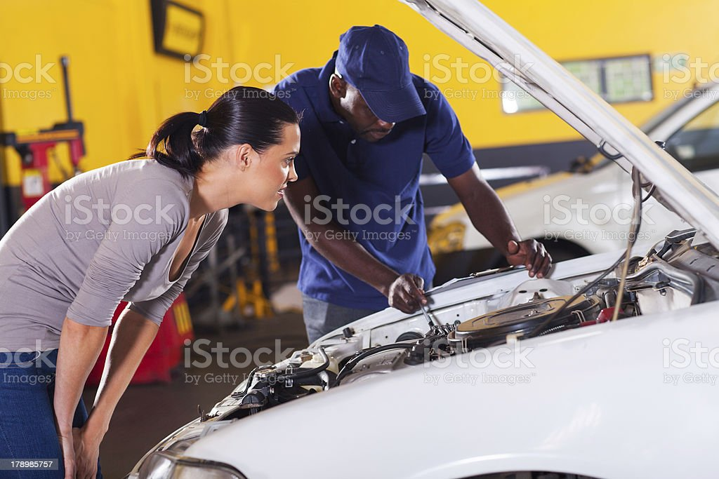 young woman sending her car for repair royalty-free stock photo