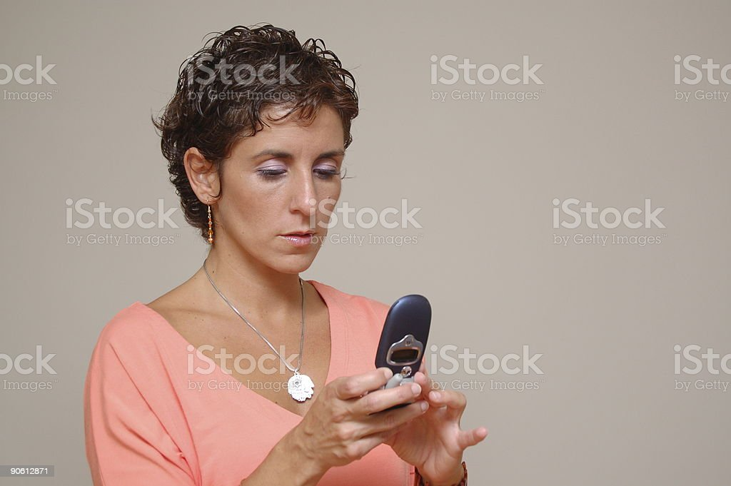 Young woman sending text message with cell phone royalty-free stock photo