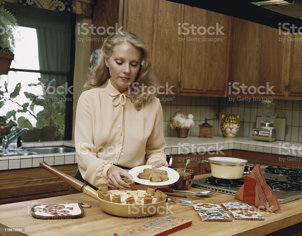 Young woman serving roulade in plate stock photo