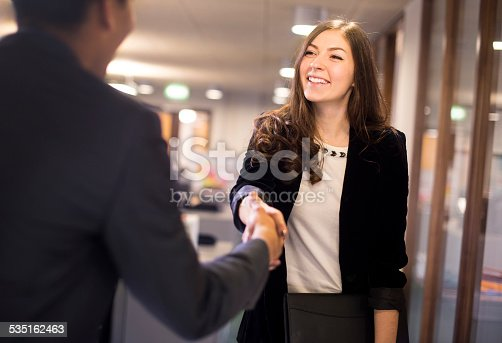 istock young woman shakes hands with her potential new boss 535162463