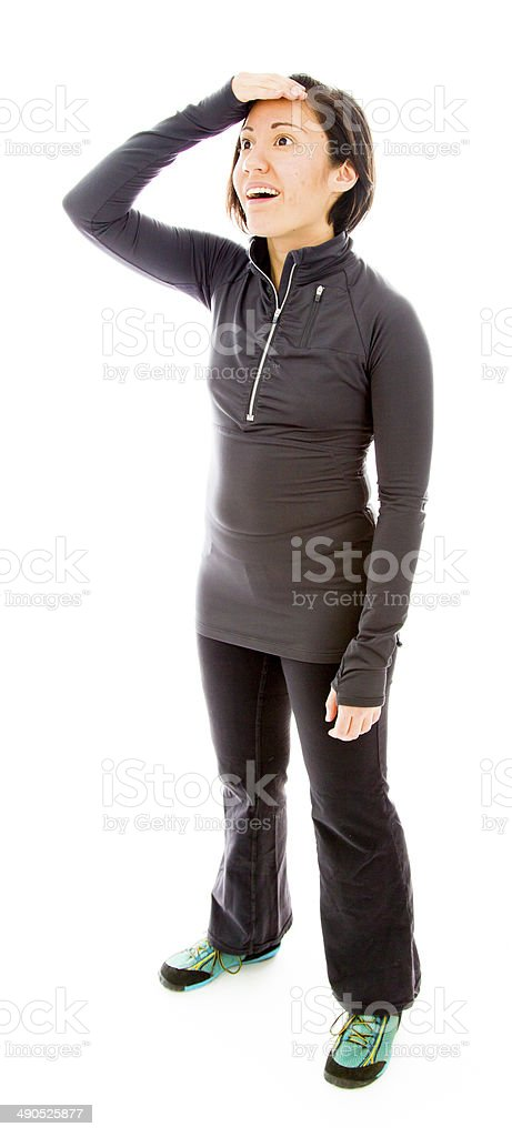 Young woman shielding her eyes royalty-free stock photo