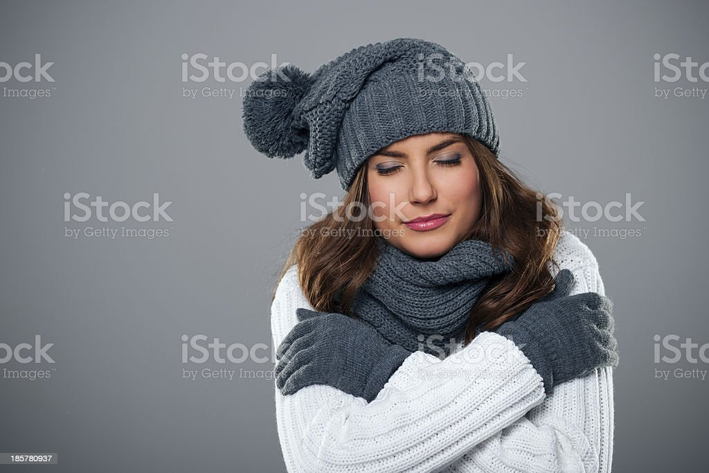 Young woman shivering during the winter season stock photo