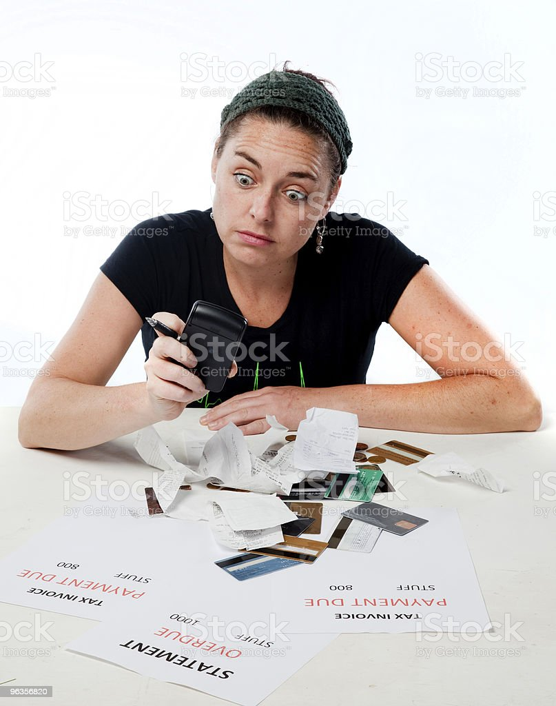 Young woman shocked by budget royalty-free stock photo