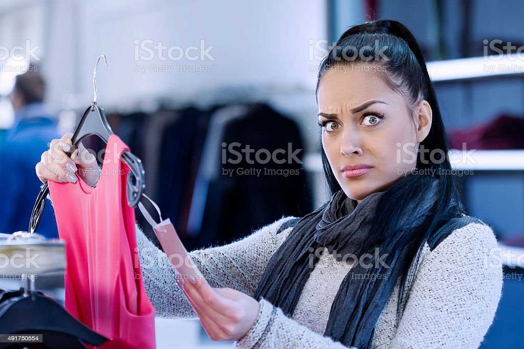 Young Woman Shocked With Price stock photo