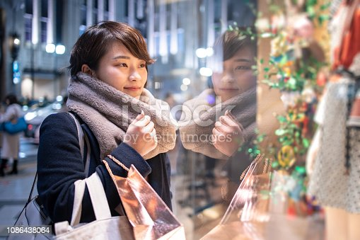 Young woman shopping after work