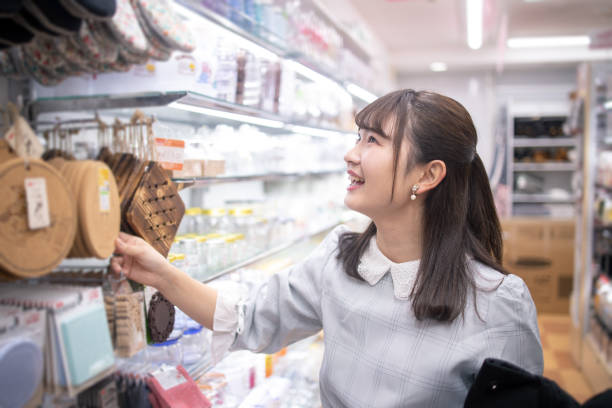 Young woman shopping at discount store Young woman shopping at discount store discount store stock pictures, royalty-free photos & images