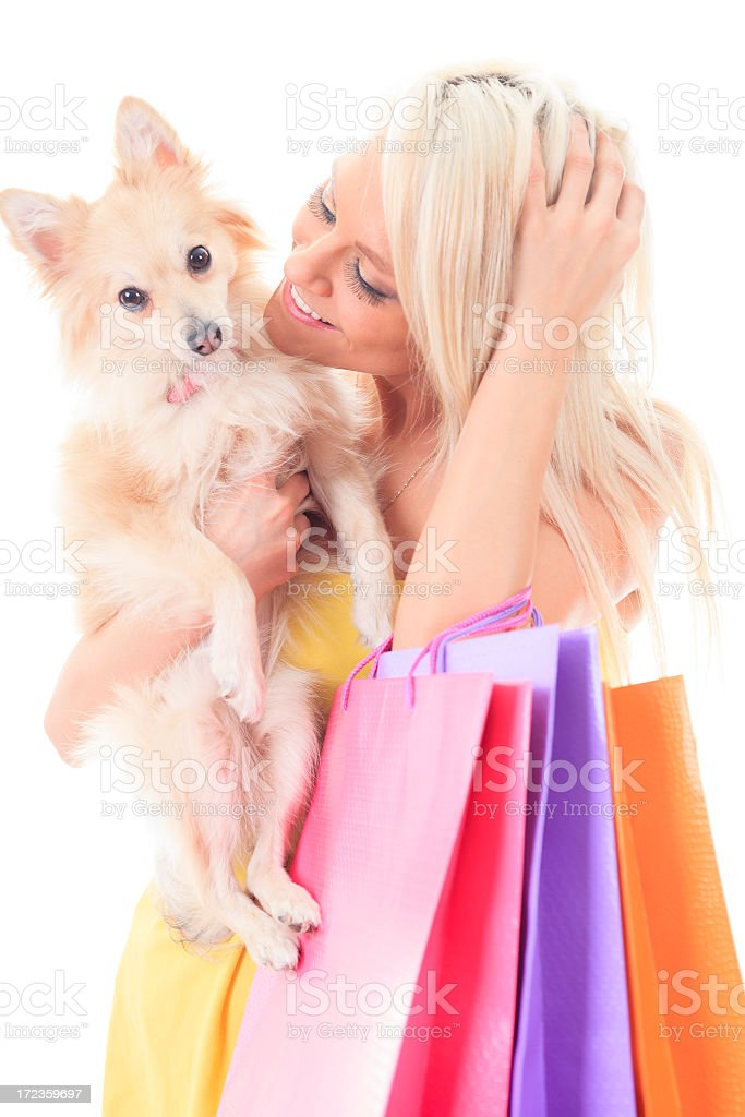 Young Woman Shopping - Dog on Hand royalty-free stock photo