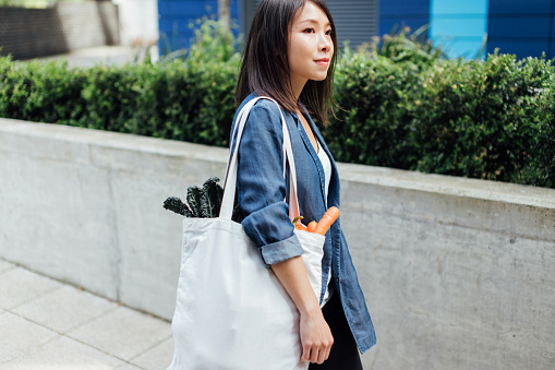 Young Woman Shopping Ethically, Living A Sustainable Lifestyle