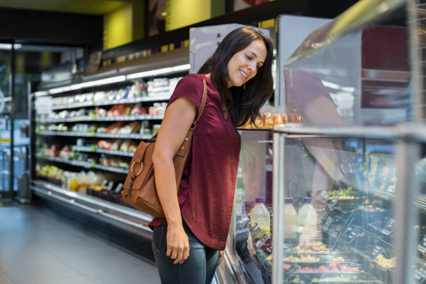 Young woman shopping food stock photo
