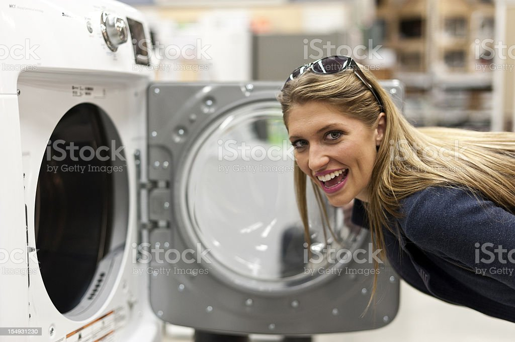 Young woman shopping for a washing machine royalty-free stock photo
