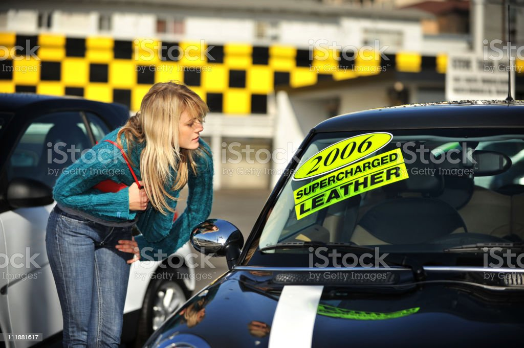 Young Woman Shopping for Cars royalty-free stock photo