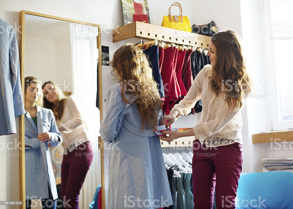 Young woman shopping for clothes royalty-free stock photo