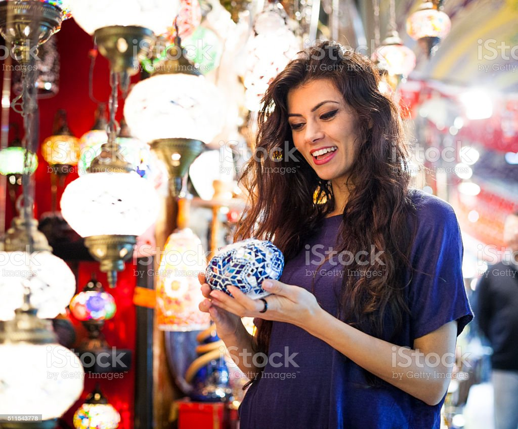 Young Woman Shopping for Gifts in Bazaar stock photo