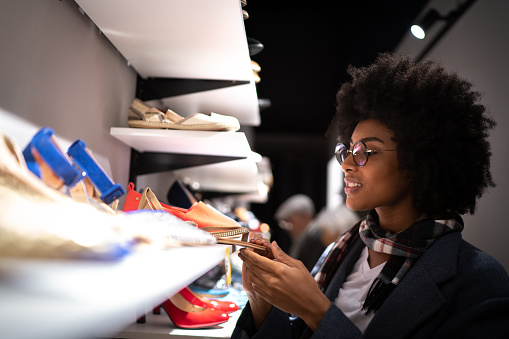 Young woman shopping for shoes