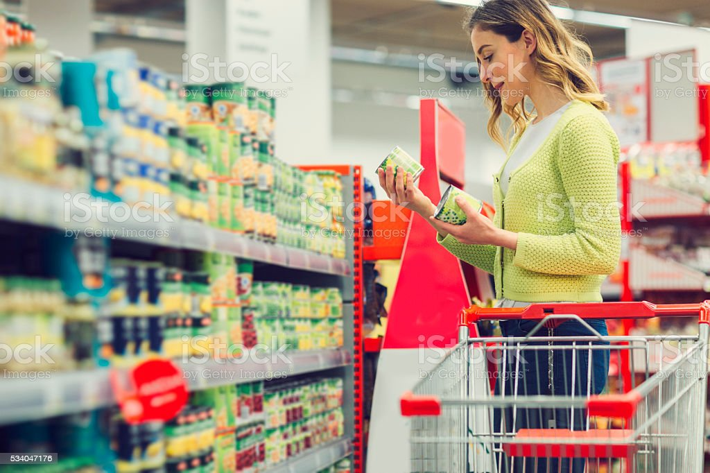 Young Woman Shopping Groceries. stock photo